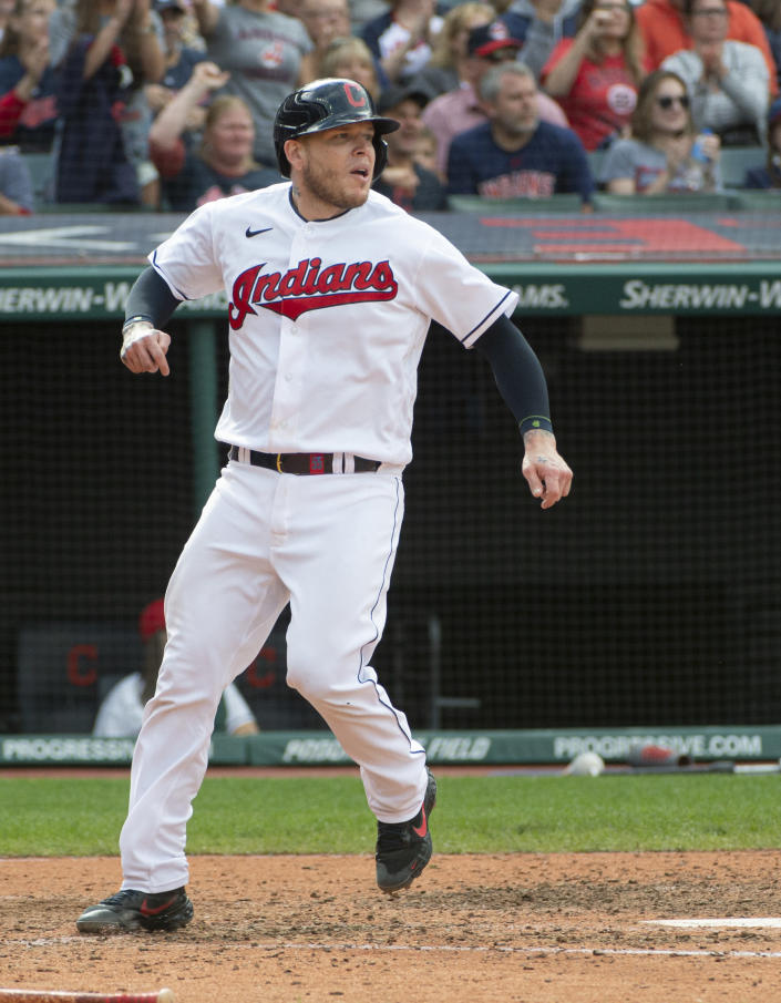 Cleveland Indians' Roberto Perez scores on an RBI-single by Myles Straw during the seventh inning of a baseball game in Cleveland, Sunday, Sept. 26, 2021. (AP Photo/Phil Long)
