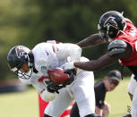 Atlanta Falcons tight end Austin Hooper (81) makes a catch as defensive back Keanu Neal (22) defends during NFL football training camp, Tuesday, Aug. 7, 2018, in Flowery Branch, Ga. (AP Photo/John Bazemore)