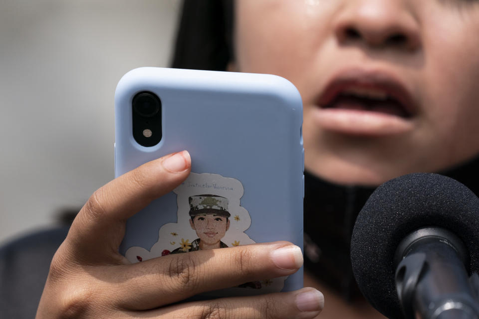 """Lupe Guillén, Vanessa Guillén's sister, speaks from notes on her phone with a sticker on it about her sister, during a news conference about the """"I Am Vanessa Guillén Act,"""" in honor of the late U.S. Army Specialist Vanessa Guillén, and survivors of military sexual violence, during a news conference on Capitol Hill, Wednesday, Sept. 16, 2020, in Washington. (AP Photo/Alex Brandon)"""