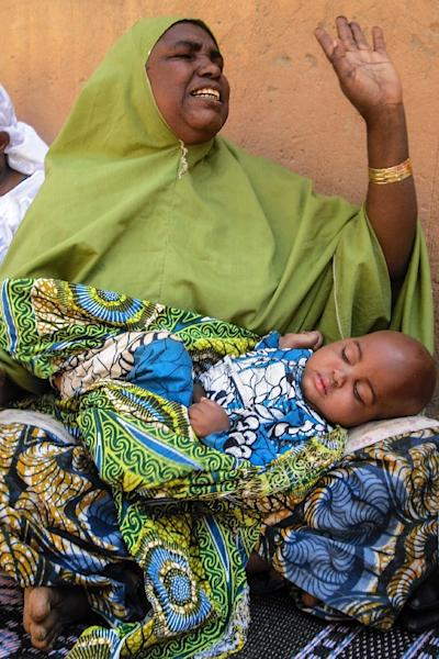 Aichatou Salifou, a witness and survivor of a Boko Haram bomb attack in Diffa, Niger on February 8, 2015, pictured on February 14, 2015 while a family member sleeps on her lap (AFP Photo/Robert Leslie)