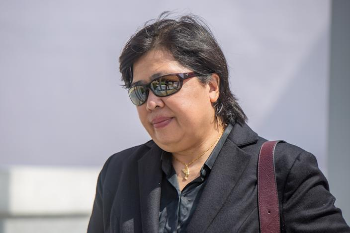 Phoon Chiu Yoke, 53, was seen leaving state courts without her mask on May 24, 2021 (PHOTO: Dhany Osman / Yahoo News Singapore)