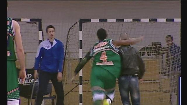American basketball star EJ Rowland floors court invader with punch at a Eurocup basketball game in Podgorica.