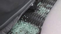 In this image taken from video, broken glass sits in the footwell of the vehicle in which the Italian ambassador to Congo was killed, according to those at the scene, in Nyiragongo, North Kivu province, Congo Monday, Feb. 22, 2021. The Italian ambassador to Congo Luca Attanasio, an Italian carabineri police officer and their Congolese driver were killed Monday in an attack on a U.N. convoy in an area that is home to myriad rebel groups, the Foreign Ministry and local people said. (AP Photo/Justin Kabumba)