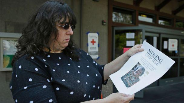 PHOTO: Jessica Tunis stands outside a Red Cross evacuation center and holds a flyer about her missing mother, Oct. 11, 2017, in Santa Rosa, Calif. (Eric Risberg/AP)