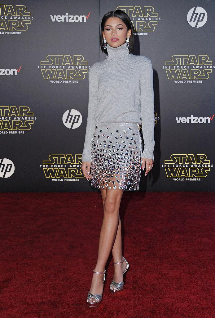 <p>For the premiere of 'Star Wars: The Force Awakens', the actress donned a grey rollneck and a sheer embellished mini skirt. NYE inspo, anyone? <em>[Photo: Getty]</em> </p>