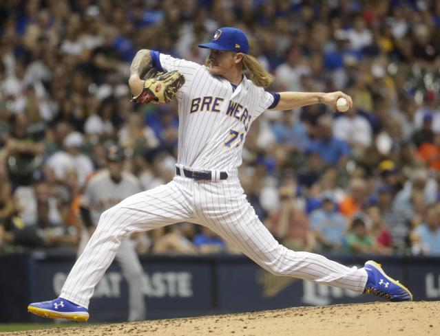 Milwaukee Brewers relief pitcher Josh Hader throws during the eighth inning of a baseball game against the San Francisco Giants Friday, July 12, 2019, in Milwaukee. (AP Photo/Morry Gash)