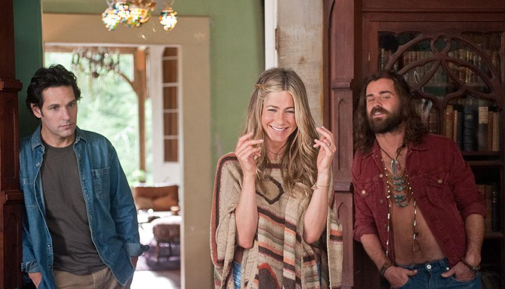 (L to R) George (PAUL RUDD), Linda (JENNIFER ANISTON) and Seth (JUSTIN THEROUX) at Elysium in ?Wanderlust?, the raucous new comedy from director David Wain and producer Judd Apatow about a harried couple who leave the pressures of the big city and join a freewheeling community where the only rule is to be yourself.