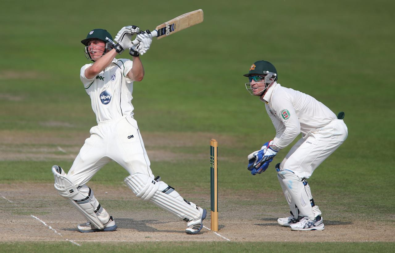 Worcestershire's batsman Tom Fell during his innings of 62 watched by wicketkeeper Brad Haddin during day four of the International Tour match at New Road at Worcester.