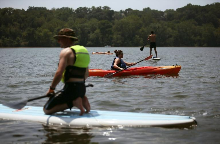 People participate in water activities on the Potomac River in July 2012 in Washington