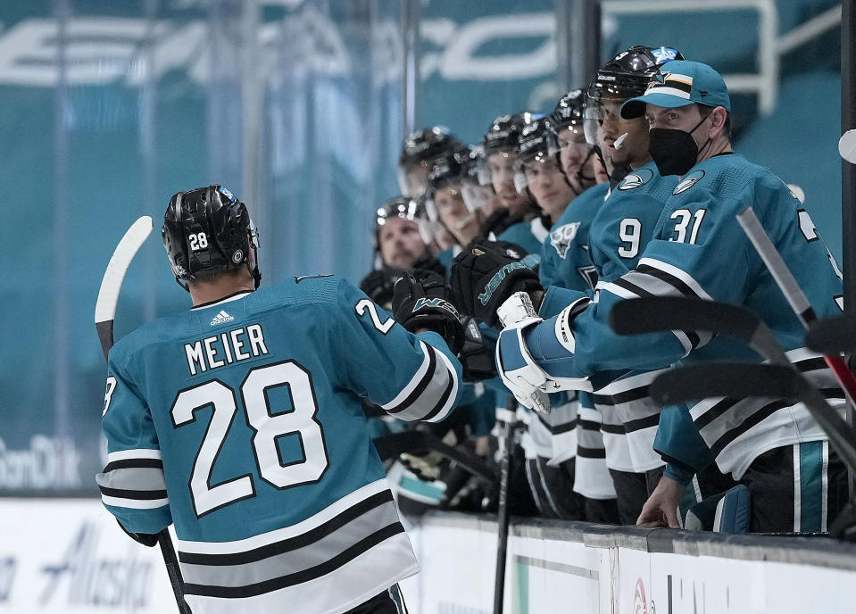 San Jose Sharks right wing Timo Meier (28) is congratulated after scoring a goal against the Los Angeles Kings during the third period of an NHL hockey game Saturday, April 10, 2021, in San Jose, Calif. The Kings won 4-2. (AP Photo/Tony Avelar)