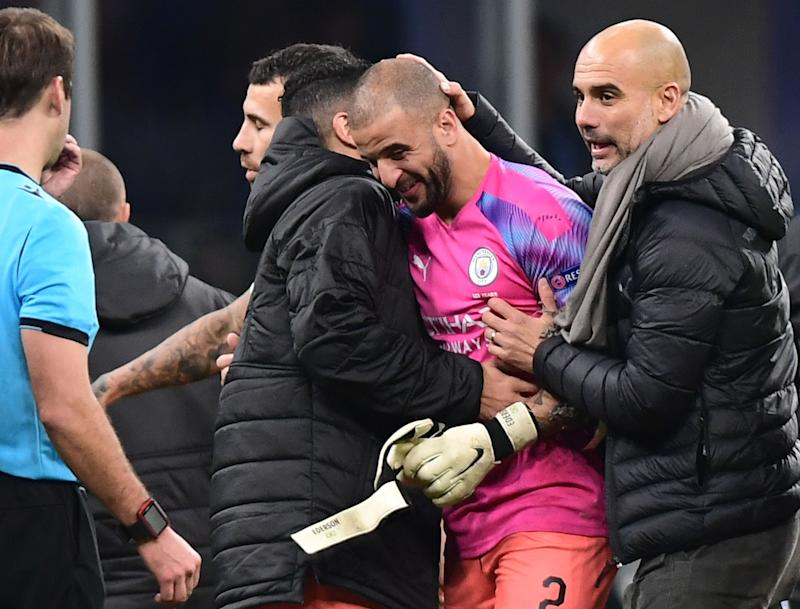 Manchester City's Spanish manager Pep Guardiola (R) congratulates Manchester City's English defender Kyle Walker who replaced the team's goalkeeper, at the end of the UEFA Champions League Group C football match Atalanta Bergamo vs Manchester City on November 6, 2019 at the San Siro stadium in Milan. (Photo by Miguel MEDINA / AFP) (Photo by MIGUEL MEDINA/AFP via Getty Images)