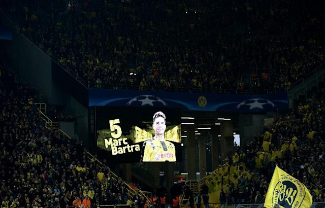 Dortmund's Spanish defender Marc Bartra's wrist was fractured and he was hit by shards of broken glass after three bombs exploded beside the Dortmund bus (AFP Photo/PATRIK STOLLARZ)