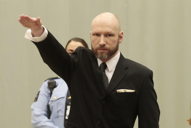 "TOPSHOT - Norwegian mass murderer Anders Behring Breivik makes a Nazi salute ahead of his appeal hearing at a court at the Telemark prison in Skien, Norway, on January 10, 2017. A Norway court begins examining the state's appeal against a ruling that it has treated mass murderer Anders Behring Breivik ""inhumanely"" since he was jailed for killing 77 people in 2011. / AFP / NTB Scanpix / Lise AASERUD / Norway OUT (Photo credit should read LISE AASERUD/AFP/Getty Images)"
