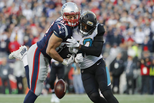 <p>New England Patriots tight end Rob Gronkowski (87) is hit by Jacksonville Jaguars strong safety Barry Church (42) during the second quarter in the AFC Championship Game at Gillette Stadium. Mandatory Credit: David Butler II-USA TODAY Sports </p>