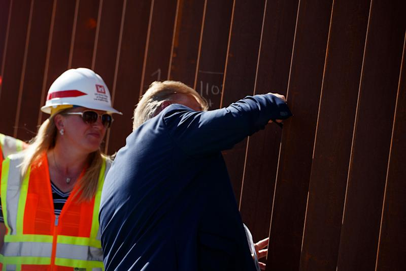 President Donald Trump signed his name on a section of the U.S.-Mexico border wall during a tour of the Otay Mesa area on Wednesday. (Photo: ASSOCIATED PRESS)