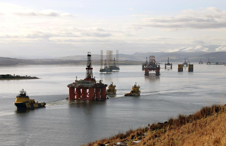<p>Oil rigs in the Cromarty Firth</p> (PA Archive)