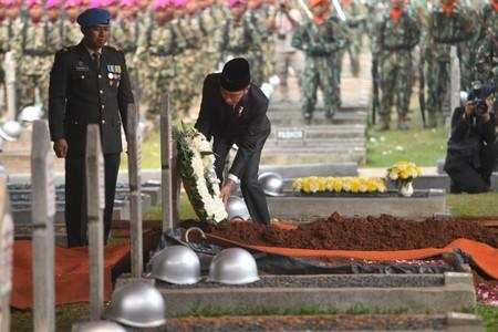 Indonesia's President Joko Widodo lays a wreath of flowers during funeral ceremony of former Indonesian President B.J. Habibie, who passed away yesterday, at Kalibata Heroes cemetery complex in Jakarta