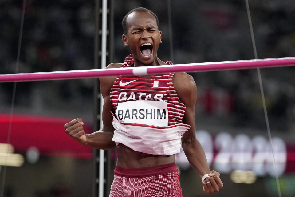 Mutaz Barshim, of Qatar, reacts in the final of the men's high jump at the 2020 Summer Olympics, Sunday, Aug. 1, 2021, in Tokyo. (AP Photo/Matthias Schrader)