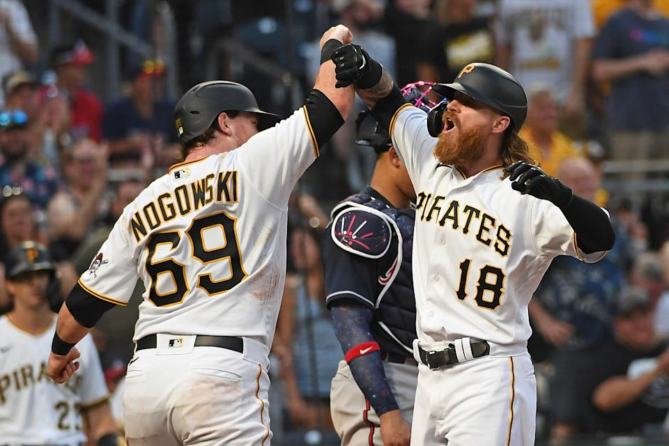 PITTSBURGH, PA - JULY 05: Ben Gamel #18 of the Pittsburgh Pirates celebrates with John Nogowski #69 after hitting a two run home run in the fourth inning during the game against the Atlanta Braves at PNC Park on July 5, 2021 in Pittsburgh, Pennsylvania. (Photo by Justin Berl/Getty Images)