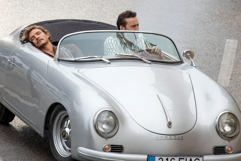 <p>Nicolas Cage and Pedro Pascal take a ride in a silver Porsche while filming <em>The Unbearable Weight of Massive Talent </em>in Dubrovnik, Croatia on Wednesday. </p>