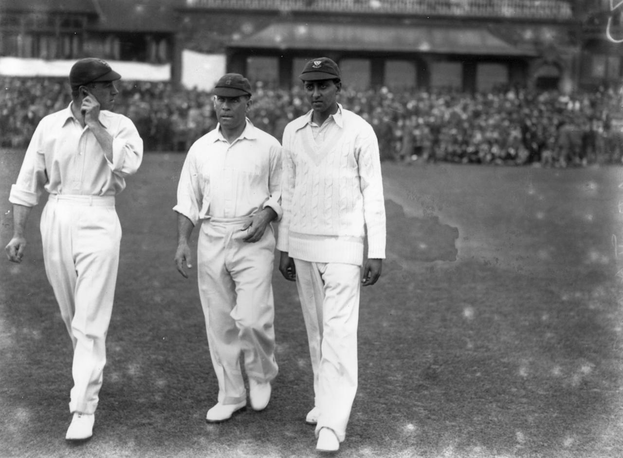 1930:  English cricketers (left to right) Wally Hammond (1903 - 1965), Patsy Hendren (1889 - 1962) and Kumar Shri Duleepsinhji (1905 - 1959)  take to the pitch at Lord's during the 1930 Ashes series; Australia regained the Ashes, winning the series 2-1.  (Photo by Central Press/Getty Images)