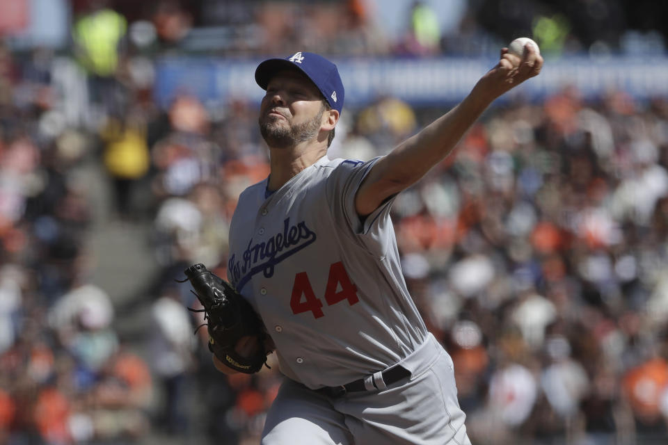 Los Angeles Dodgers starting pitcher Rich Hill throws to a San Francisco Giants batter during the first inning of a baseball game in San Francisco, Sunday, Sept. 29, 2019. (AP Photo/Jeff Chiu)
