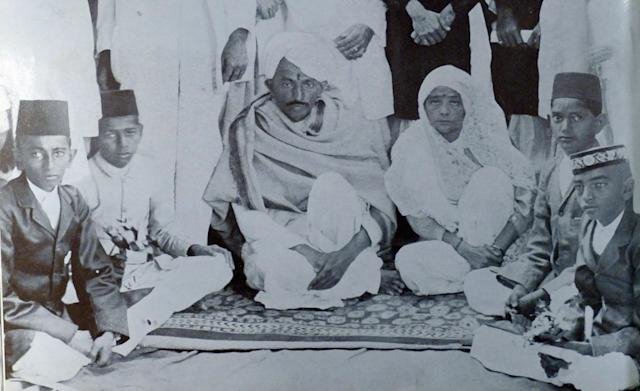 Mohandas Karamchand Gandhi and Kasturba. at a reception given in Ahmedabad. 1915. Gandhi (2 October 1869 Ð 30 January 1948). was the preeminent leader of the Indian independence movement in British-ruled India. Employing nonviolent civil disobedience. Gandhi led India to independence and inspired movements for civil rights and freedom across the world. (Photo by: Universal History Archive/Universal Images Group via Getty Images)