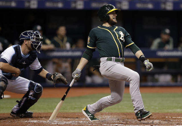 FILE - In this Sept. 15, 2018, file photo, Oakland Athletics' Jed Lowrie, right, lines an RBI-single off Tampa Bay Rays pitcher Yonny Chirinos as Rays catcher Nick Ciuffo, left, looks on during the third inning of a baseball game in St. Petersburg, Fla. A person familiar with the negotiations tells The Associated Press that free agent Lowie and the New York Mets have agreed to a $20 million, two-year contract. The person spoke on condition of anonymity Thursday, Jan. 10, 2019, because the agreement is subject to a successful physical. (AP Photo/Chris O'Meara, File)