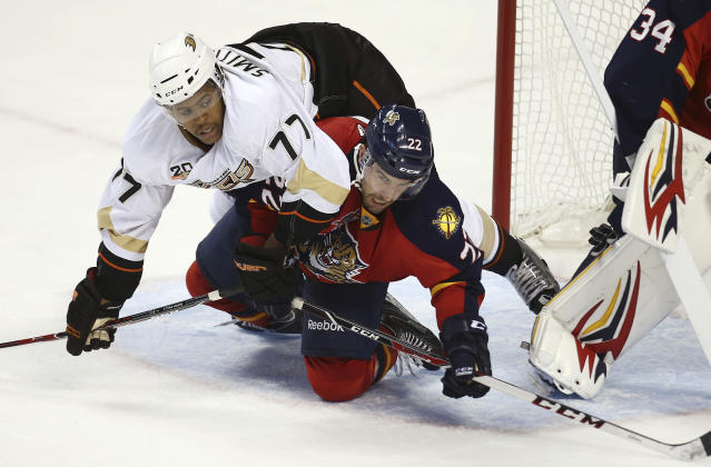 Anaheim Ducks' Devante Smith-Pelly (77) and Florida Panthers' Mike Mottau (22) compete for the puck during the third period of an NHL hockey game in Sunrise, Fla., Tuesday, Nov. 12, 2013. The Panthers won 3-2. (AP Photo/J Pat Carter)