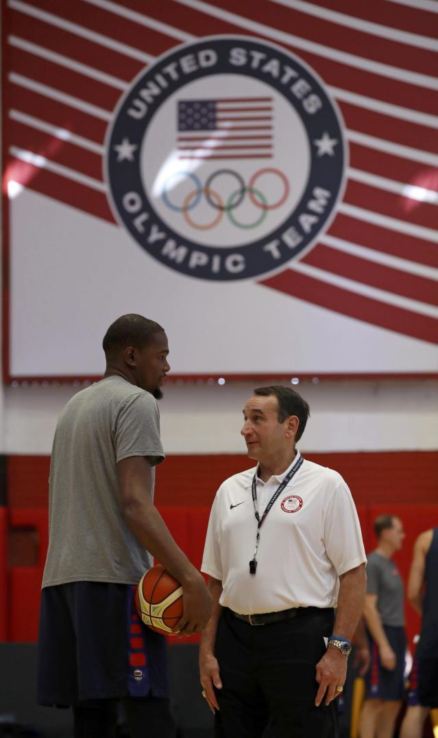 2016 Rio Olympics - Basketball - Preliminary - USA men's training session - Flamengo Club - Rio de Janeiro, BrazilHead coach Mike Krzyzewski speaks with Kevin Durant (USA) of the U.S. during training. REUTERS/Jim Young FOR EDITORIAL USE ONLY. NOT FOR SALE FOR MARKETING OR ADVERTISING CAMPAIGNS.