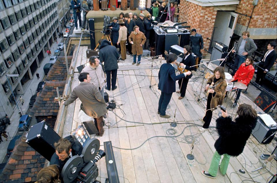 """The Beatles film the rooftop sequence for the """"Let It Be"""" film in January 1969, as pictured in the book """"Get Back"""" - Credit: Courtesy Apple"""