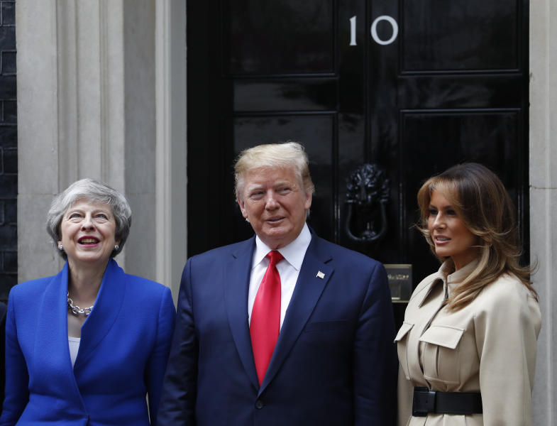 Britain's Prime Minister Theresa May welcomes President Donald Trump and first lady Melania, right, outside 10 Downing Street in central London, Tuesday, June 4, 2019. President Donald Trump will turn from pageantry to policy Tuesday as he joins British Prime Minister Theresa May for a day of talks likely to highlight fresh uncertainty in the allies' storied relationship. (AP Photo/Alastair Grant)