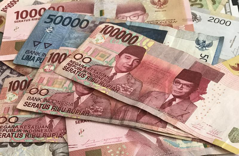 Picture of bills of Indonesian currency - the Rupiah - taken in Jakarta, Indonesia, 15 August 2017. Photo: Christoph Sator/dpa (Photo by Christoph Sator/picture alliance via Getty Images)