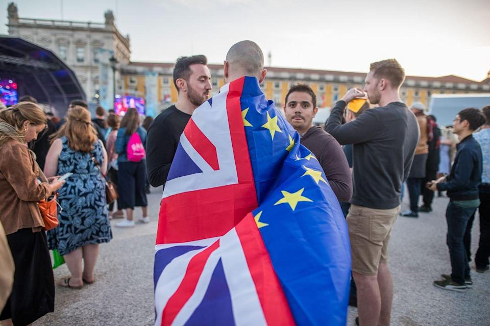 Looks like this chap, pictured at a public viewing of the second semi-final of this year's contest in Lisbon, would like Eurovision to Remain (Rex)