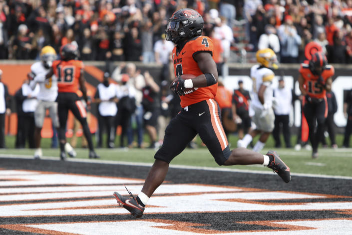 Oregon State running back B.J. Baylor (4) strides in to the end zone for a touchdown during the first half of an NCAA college football game against Idaho on Saturday, Sept. 18, 2021, in Corvallis, Ore. (AP Photo/Amanda Loman)