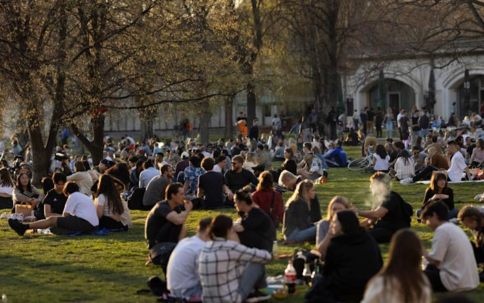 People sit in a park on a warm day with temperatures up to 23 degrees during the coronavirus pandemic - Maja Hitij/Getty Images Europe