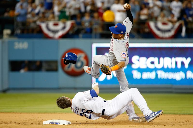 Ruben Tejada of the New York Mets is hit by a slide by Chase Utley of the Los Angeles Dodgers in the seventh inning of game two of the National League Division Series at Dodger Stadium on October 10, 2015 in Los Angeles, California