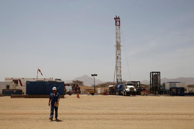FILE PHOTO: Worker walks at a Tullow Oil explorational drilling site in Lokichar