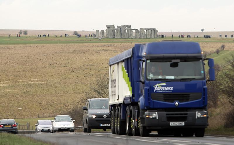 """File photo dated 06/02/17 of traffic passing Stonehenge on the A303 road in Wiltshire. The economic case for building a road tunnel near Stonehenge relies on """"uncertain"""" benefits, the public spending watchdog has warned."""
