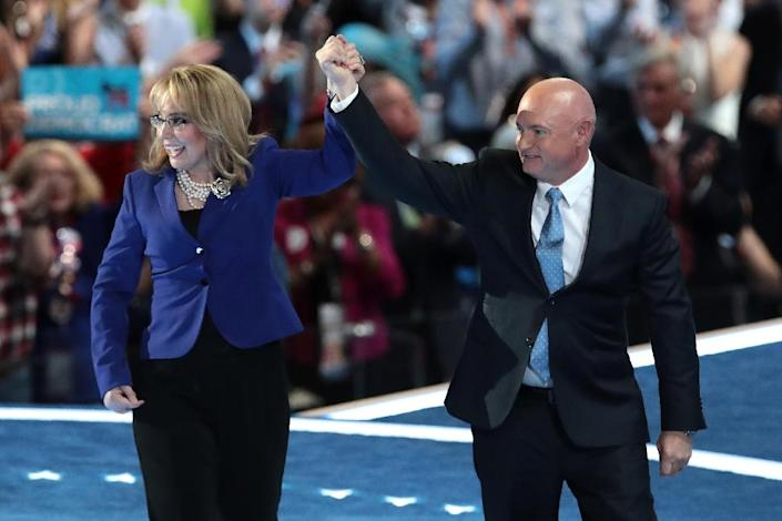 Former NASA astronaut Mark Kelly holds hands with his wife, former congresswoman Gabby Giffords, after delivering remarks at the 2016 Democratic National Convention (AFP Photo/Drew Angerer)
