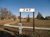 """<p>Particulars of the naming of this town are mysterious, though some like to believe it was named after a prominent banking family <a href=""""http://web.archive.org/web/20070927222627/http://www.prairiepublic.org/programs/datebook/bydate/04/0504/051004.jsp"""" rel=""""nofollow noopener"""" target=""""_blank"""" data-ylk=""""slk:with the last name Zapp"""" class=""""link rapid-noclick-resp"""">with the last name Zapp</a>. Mostly well known for its """"Zip to Zap"""" riot.</p><p><a href=""""https://flic.kr/p/6pviEt"""" rel=""""nofollow noopener"""" target=""""_blank"""" data-ylk=""""slk:Photo by Andrew Filer via Flickr"""" class=""""link rapid-noclick-resp""""><em>Photo by Andrew Filer via Flickr</em></a></p>"""