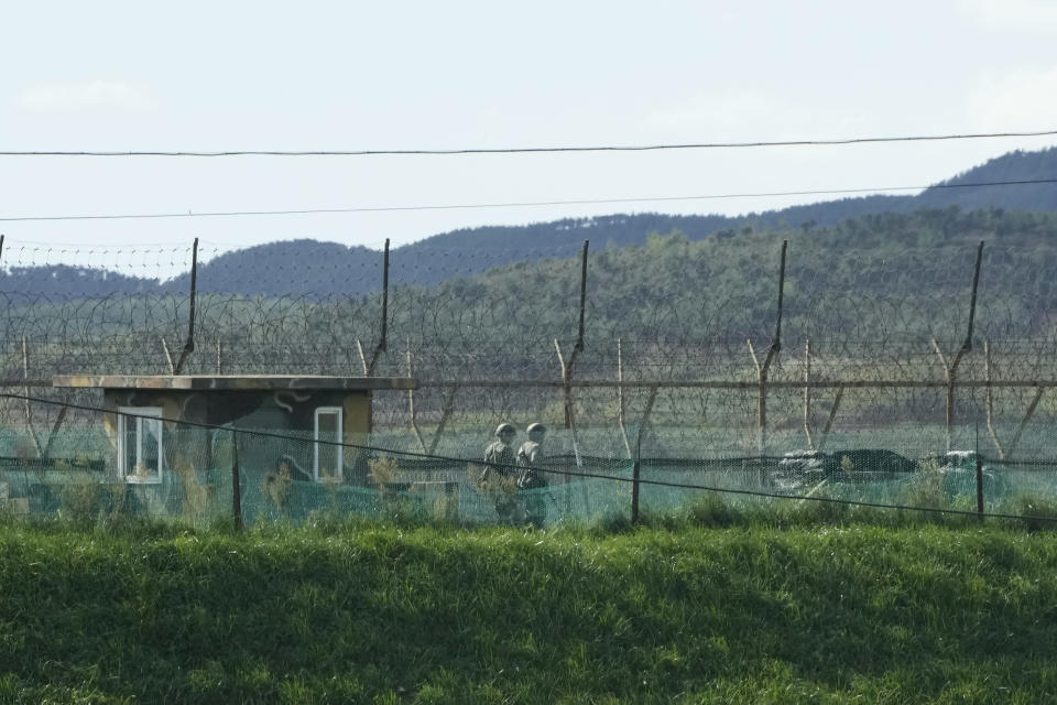 South Korean army soldiers patrol along the barbed-wire fence in Paju, South Korea, near the border with North Korea, Sunday, Sept. 26, 2021. The powerful sister of North Korean leader Kim Jong Un said Saturday that her country will take steps to repair ties with South Korea, and may even discuss another summit between their leaders, if the South drops what she described as hostility and double standards. (AP Photo/Ahn Young-joon)