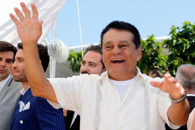 """FILE PHOTO: Former boxer Roberto Duran gestures as he arrives at a photocall for the film """"Hands of stone"""" out of competition at the 69th Cannes Film Festival in Cannes"""