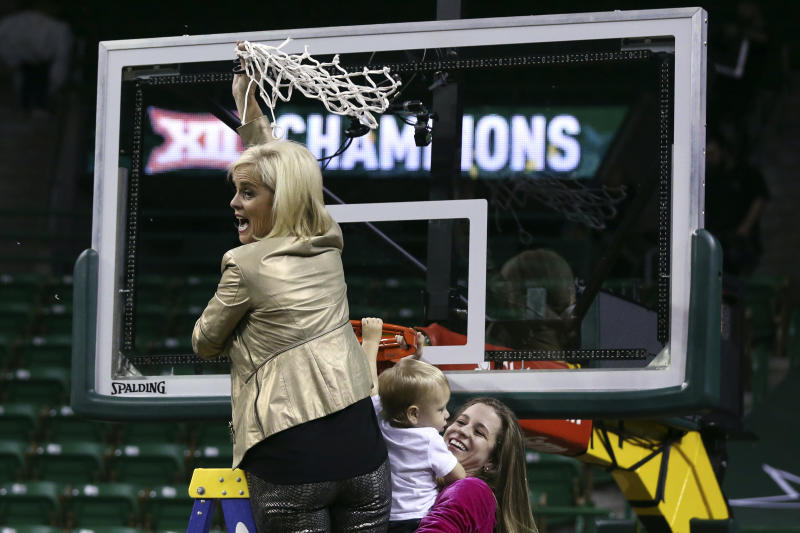 Baylor head coach Kim Mulkey cuts the net down with her daughter, assistant coach Makenzie Fuller, and Fuller's son, Kannon Reid Fuller, after defeating Kansas State in an NCAA college basketball game, Saturday, Feb. 29, 2020, in Waco, Texas. (AP Photo/Rod Aydelotte)