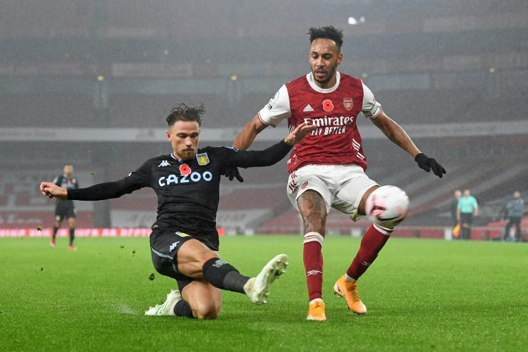 Arsenal forward Pierre-Emerick Aubameyang (R) is thwarted by Aston Villa defender Matty Cash during an English Premier League match in London Sunday.