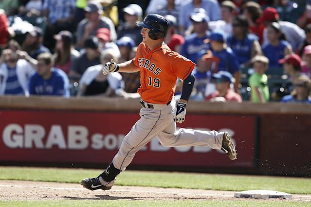 Houston Astros' Robbie Grossman rounds first base on a single against the Texas Rangers during the eighth inning of a baseball game, Sunday, April 13, 2014, in Arlington, Texas. The Rangers won 1-0. (AP Photo/Jim Cowsert)