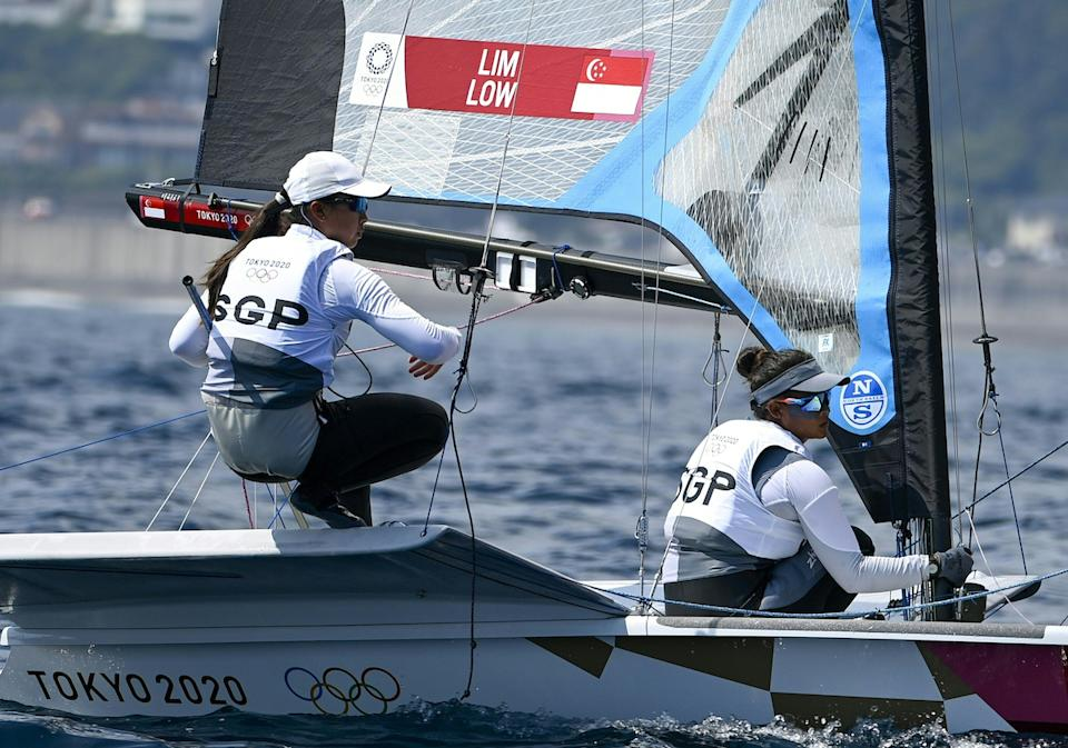 Singapore sailors Kimberly Lim and Cecilia Low in the women's 49er FX race during the 2020 Tokyo Olympics. (PHOTO: Olivier Morin/ AFP)