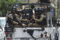 Paramilitary soldiers patrol near the Pakistan Stock Exchange building following an attack by gunmen in Karachi on June 29, 2020. - At least six people were killed when gunmen attacked the Pakistan Stock Exchange in Karachi on June 9, with a policeman among the dead after the assailants opened fire and hurled a grenade at the trading floor, authorities said. (Photo by Asif HASSAN / AFP) (Photo by ASIF HASSAN/AFP via Getty Images)