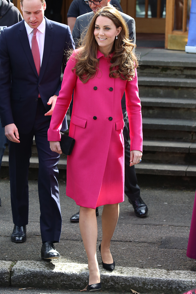 <p>Here's Kate wearing an equally eye-catching raspberry coat dress in South London when she was pregnant with Princess Charlotte in March 2015.</p>