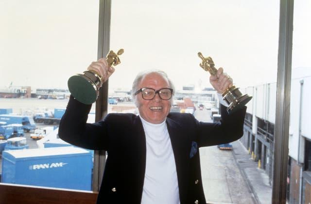 Sir Richard Attenborough arrives at Heathrow Airport with the Oscars he won for his film Gandhi (PA)